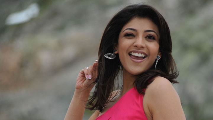 Kajal Aggarwal Laughing Naughty Pose In Pink Dress